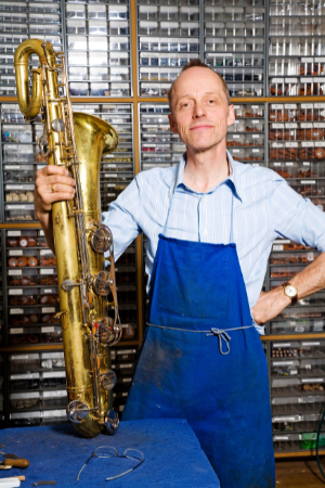 The expert repairs bass saxophones as well as the soprano saxophone.